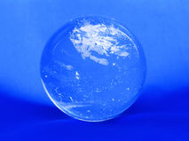 Crystal ball on a blue Royalty Free Stock Photo