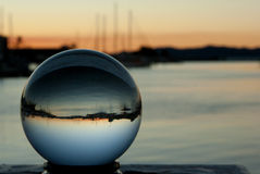 Crystal ball with boats. Reflected at sunset Stock Image