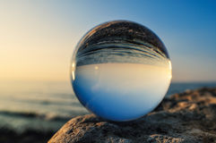 Crystal Ball. On the boulder at the sea Stock Images
