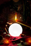 Crystal ball, candle and hand of gypsy fortune teller woman royalty free stock image