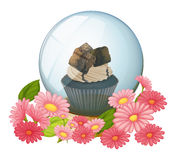 A crystal ball with a chocolate flavored cupcake Royalty Free Stock Photos