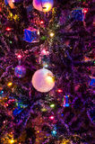 Crystal ball on christmas tree with lighting Stock Photography