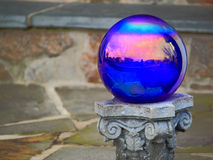 Crystal Ball. With community houses reflection outside Royalty Free Stock Images