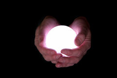 Crystal ball concept for future. Business man holds glowing crystal ball against black background Royalty Free Stock Photo