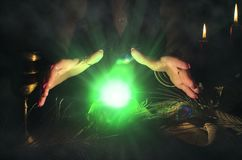 Crystal ball. Crystal ball and fortune teller hands. Divination. Seance Stock Photos