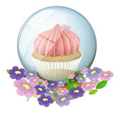 A crystal ball with a cupcake inside Royalty Free Stock Photography