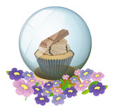 A crystal ball with a cupcake inside Stock Photography