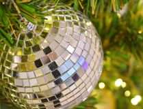 Crystal ball decorated on Christmas tree with yellow light tone as a blurred background royalty free stock photos