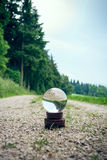 Crystal ball on a dirt road Royalty Free Stock Image