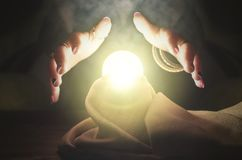 Crystal ball. Crystal ball and fortune teller hands. Divination. Seance Royalty Free Stock Photos