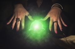 Crystal ball. Crystal ball and fortune teller hands. Divination. Seance Royalty Free Stock Photography