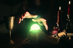 Crystal ball. Crystal ball and fortune teller hands. Divination. Seance Stock Images