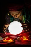 Crystal ball for fortune telling and hands of gypsy fortune tell Stock Photo