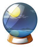 A crystal ball with a fullmoon inside Stock Images