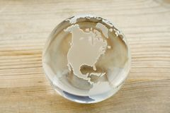Crystal ball globe. On a pine wood surface - add your text or image Stock Photos