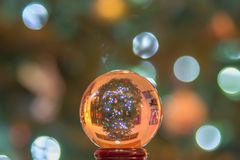 Crystal ball globe with christmas tree up side down stock images