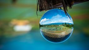 Crystal Ball With Green Field. And Natural Mountain View Background royalty free stock photo