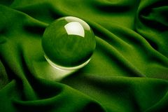 Crystal Ball on green. Transparent Crystal ball with green background , close up stock photos