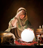 Crystal ball gypsy. Crystal ball illuminating a young fortune telling gypsy Royalty Free Stock Photo