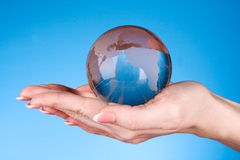 Crystal ball on hand. Stock Photos