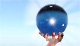 Crystal ball. Hand holding up a crystal ball Stock Photography