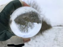 Creative concept : crystal ball in winter landscape stock photo