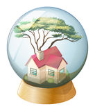 A crystal ball with a house Stock Images
