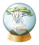 A crystal ball with a house inside Royalty Free Stock Photo