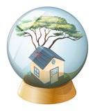 A crystal ball with a house inside Stock Photography