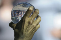 Crystal ball juggling. TORONTO-AUGUST 25: A performer holding a crystal ball during the Buskerfest Festival on August 25, 2012 in Toronto, Canada Stock Image
