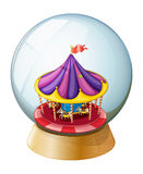 A crystal ball with a kiddie ride inside Stock Photo