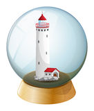 A crystal ball with a lighthouse inside Royalty Free Stock Photo