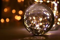 Crystal ball with lights in the back Royalty Free Stock Photography