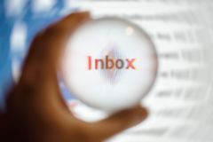 Crystal ball magnify word inbox. Crystal ball magnify screen word inbox, email concept stock photo