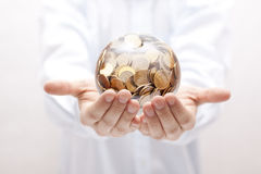 Crystal ball with money in hands Royalty Free Stock Images