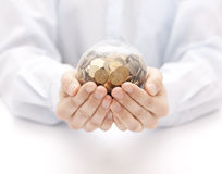 Crystal ball with money in hands. Man holding a crystal ball with money in hands Stock Image