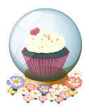 A crystal ball with a mouthwatering cupcake Royalty Free Stock Images