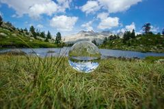 Crystal ball on natural environment, mountains, landscape stock photo