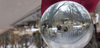 Crystal Ball With Nature Background Bola da lente com uma vista bonita no parque fotografia de stock royalty free