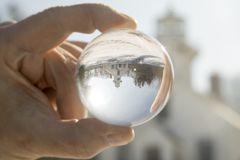 Crystal ball at Old Mission Lighthouse, Traverse City,  Michigan. Crystal ball reflecting exterior of Old Mission Lighthouse in Traverse CIty, Michigan in winter Stock Image