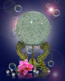 Crystal ball orchids pearls. Image and illustration composition of mystical crystal ball, brass stand with light refractions on blue background with pink orchids Royalty Free Stock Image