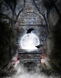 Crystal ball in passageway. A crystal ball filled with stars and electricity on an ornate pedestal in a mystical passageway.  Concept for the occult or mystical Stock Photos