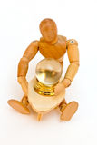 Crystal Ball Reading. Wooden artist's drawing mannequin with a miniature crystal ball and table. Concept of psychic, medium, or fortune teller. White isolated Stock Photography