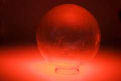 Crystal ball in red light Stock Photo