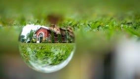Crystal Ball With Residential House fotografie stock libere da diritti