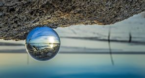 Crystal ball at seaside. With reflection Royalty Free Stock Images