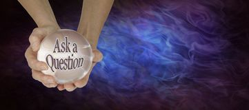 Crystal Ball showing Ask a Question. Pair of hands holding a large crystal ball showing ASK A QUESTION on gaseous wispy black and blue background with  copy Royalty Free Stock Photos