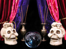 Crystal Ball With Skulls Stock Photos