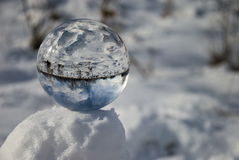 Crystal ball in snow Royalty Free Stock Photos