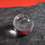 Crystal ball on stone surface Stock Image